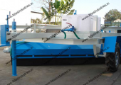 Mechanical broom with water sprinkling system
